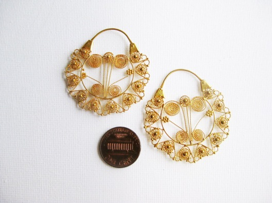 Reproduction earrings in a much bigger size.