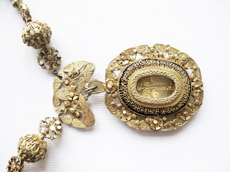 Big ornate silver dipped in gold tamborin necklace
