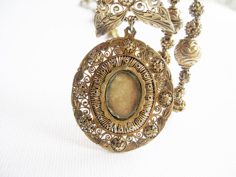 Vintage reliquary or relikaryo pendant old philippine jewelry antique gold plated silver reliquary with paper inside aloadofball Image collections